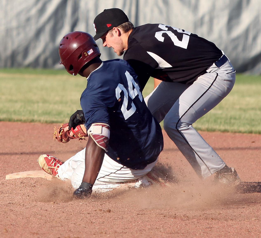 . Randy Meyers - The Morning Journal Jesse Barrios of the Ironmen applies the tag for the out on Brenden Spaulding of the Spartans at second base on Monday.