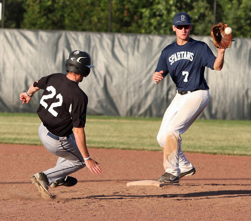 . Randy Meyers - The Morning Journal Jesse Barrios of the Ironmen is forced out at second base by Spartan infielder Alex Ludwick on Monday.