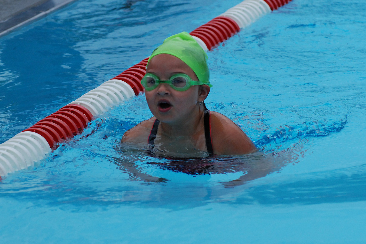 Madelyn competing in the breast stroke.