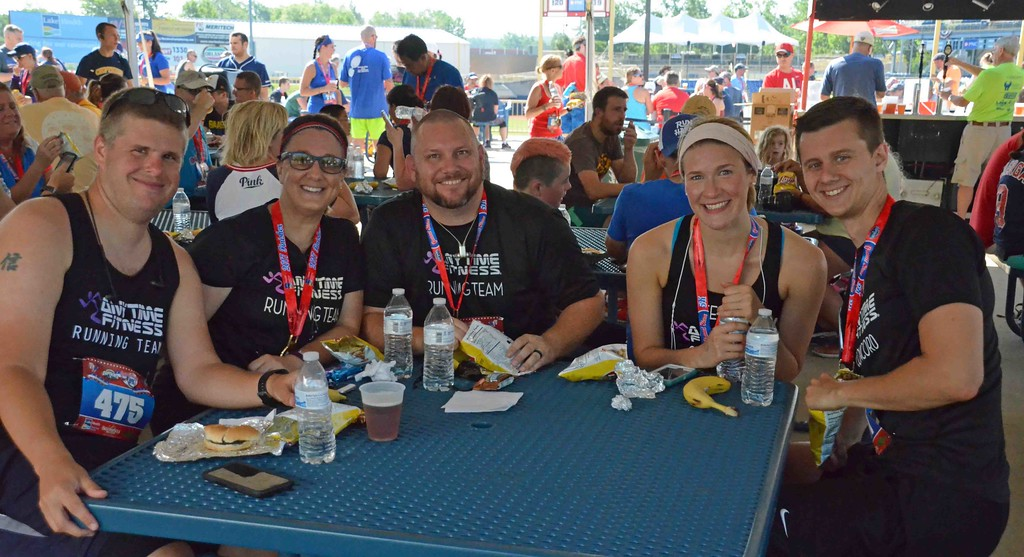 . Paul DiCicco - The News-Herald A few members of one of the many running teams, take a break for some food and drink after the 2017 Captains Grand Slam 5K on July 2.