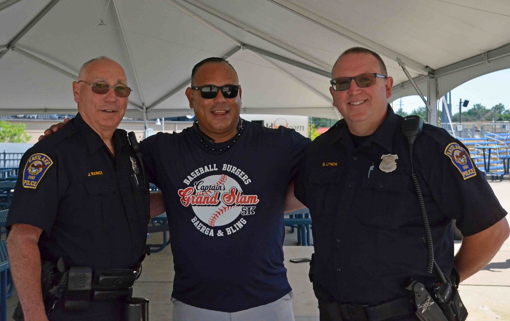 . Paul DiCicco - The News-Herald Carlos Baerga posing with a couple of Eastlakes finest, Officers Rarick and Lynch.
