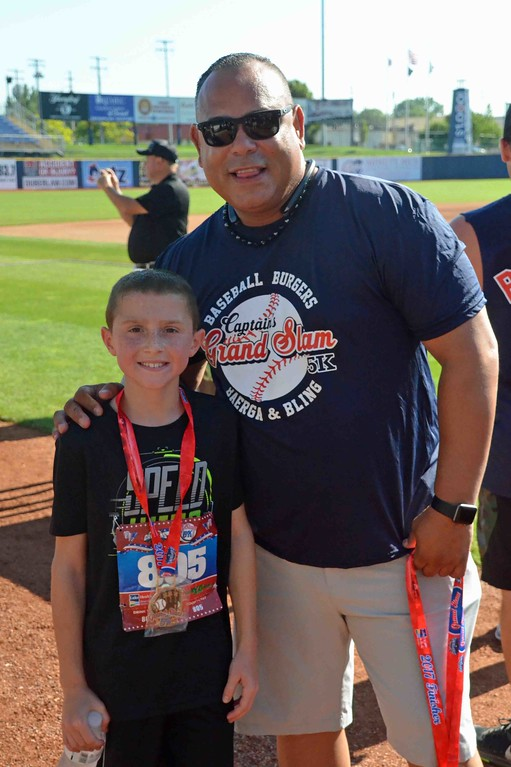 . Paul DiCicco - The News-Herald Runner Billy Dennison of Mentor (10) poses with Carlos Baerga.