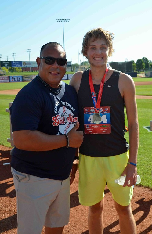 . Paul DiCicco - The News-Herald  Overall and Mens division winner, Nick Amos, poses with Carlos Baerga.