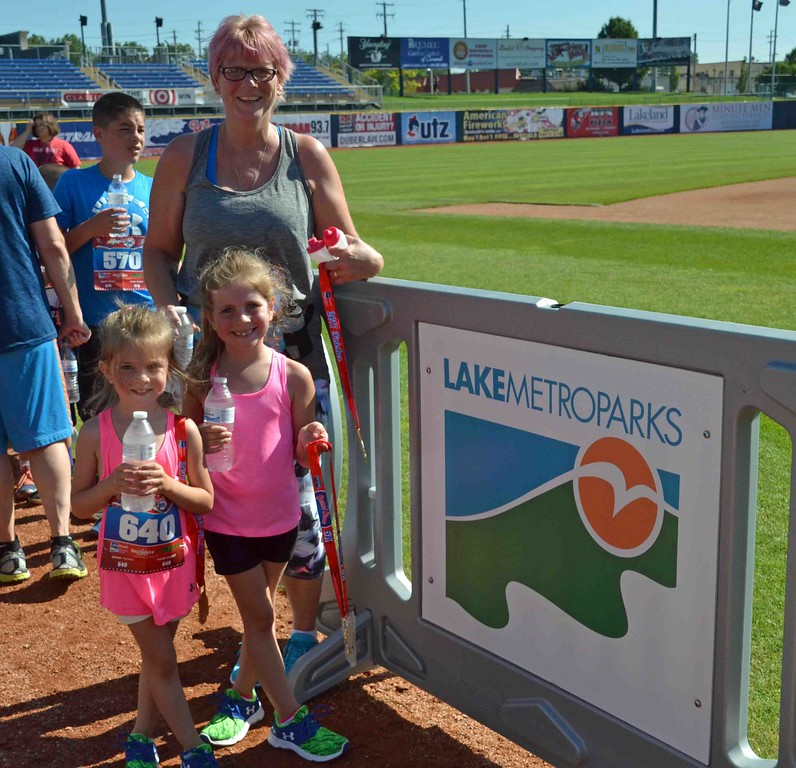 . Paul DiCicco - The News-Herald  Sophia (left -4yrs old) and her family stop for a picture at the 2017 Captains Grand Slam 5K on July 2.