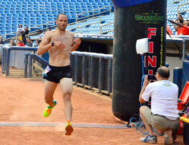 Brittany Chay - The News-Herald<br /> Stephen Benesh wins the Captains Grand Slam 5K on July 3 at Classic Park in Eastlake.