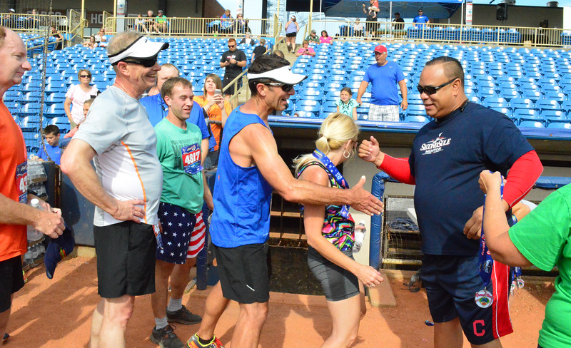 Brittany Chay - The News-Herald<br /> Former Indians great Carlos Baerga greets runners after the Captains Grand Slam 5K on July 3 at Classic Park in Eastlake.