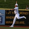 Randy Meyers - The Morning Journal<br /> Crushers outfielder Sean Hurley   dives after a long fly ball near the left field wall on Monday against   Evansville