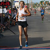Michael Johnson - The News-Herald<br /> Ryan Polman crosses the finish line with a time of 25 minutes, 27 seconds during the 40th Johnnycake Jog on July 10, 2016.