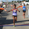 Michael Johnson - The News-Herald<br /> Tewabech Demse crosses the finish line to place first in the women's 5 mile run at the 40th Johnnycake Jog on July 10, 2016.