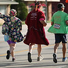 """Michael Johnson - The News-Herald<br />  """"The Couch Potatoes"""" running group runs in the 40th Johnnycake Jog on July 10, 2016."""