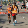 Michael Johnson - The News-Herald<br />  Hillary Too, right, passes Rachid Ezzouniou during the final stretch to win the the 40th Johnnycake Jog on July 10, 2016.