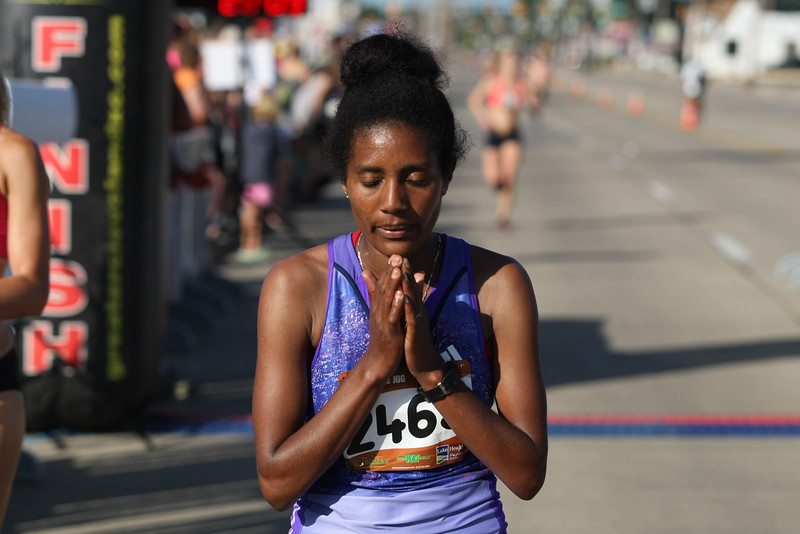 Michael Johnson - The News-Herald<br />  Tewabech Demse gathers herself after winning the women's 5-mile run during the 40th Johnnycake Jog on July 10, 2016.