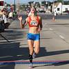 Michael Johnson - The News-Herald<br />  Gabriella Kruez crosses the finish line during the 40th Johnnycake Jog on July 10, 2016.