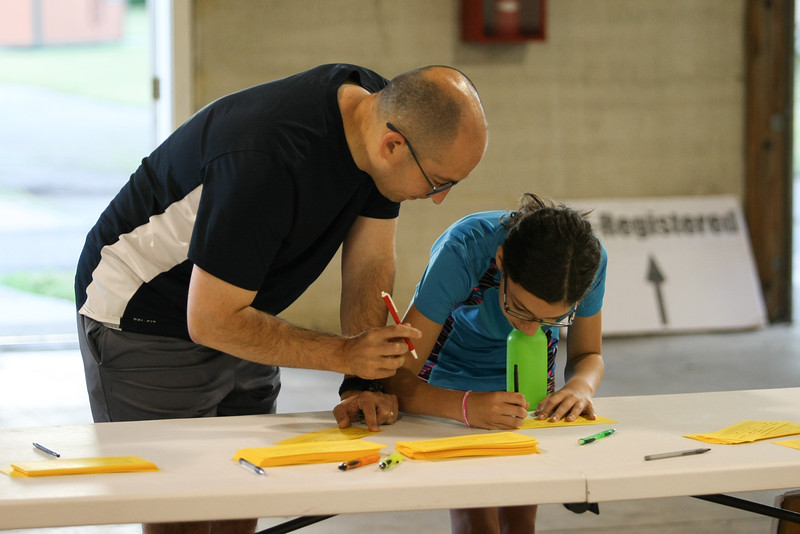 Michael Johnson - The News-Herald<br />  Tod McCloskey and his daughter Ella sign up to race prior to the 40th Johnnycake Jog on July 10, 2016.