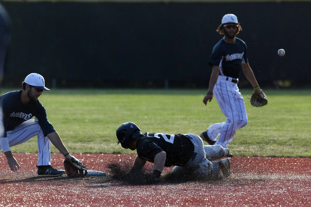 . Jen Forbus - The Morning Journal  Ironman Eric Wentz slides into second base.