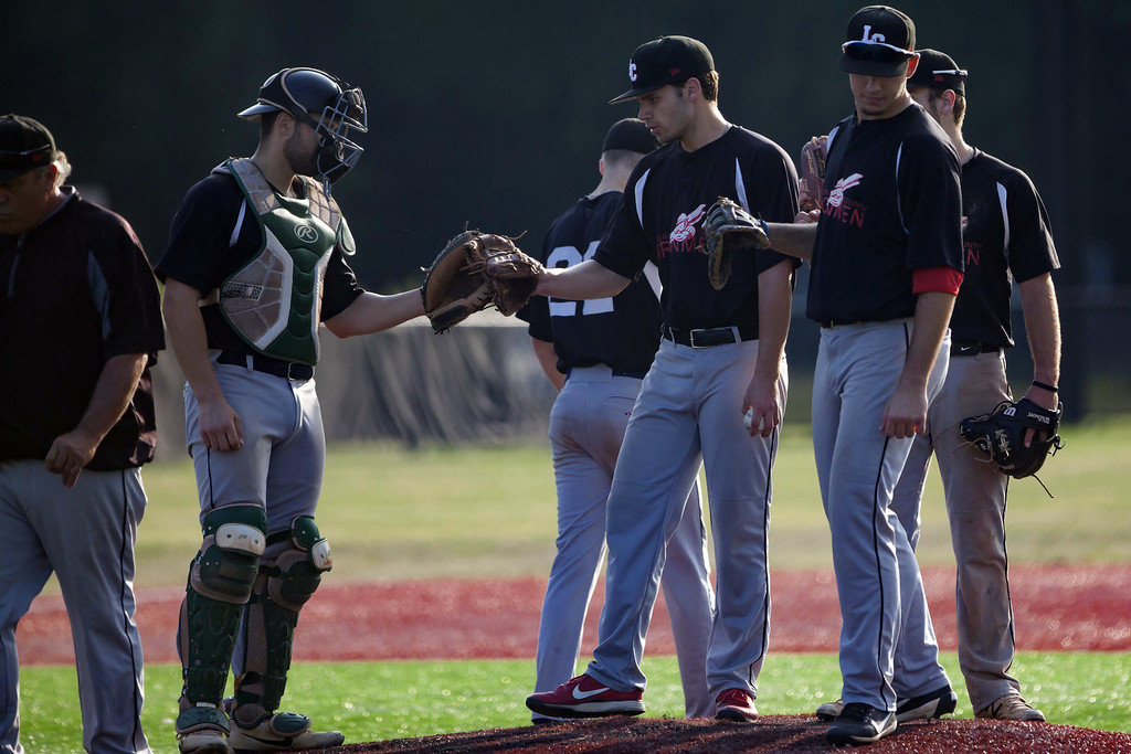 . Jen Forbus - The Morning Journal The Ironmen infield offers some encouragement to pitcher William Laidlaw.