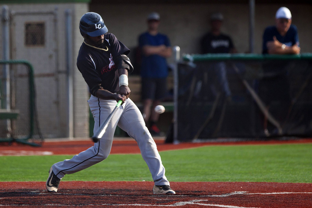 . Jen Forbus - The Morning Journal - Lorain County\'s Robert Williams takes a swing at a pitch during the Ironmen\'s game against Lake Erie Warhawks.