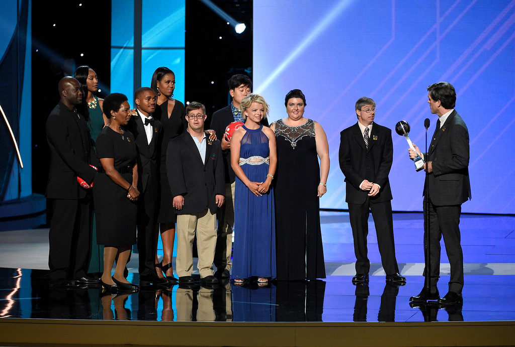 . Timothy Shriver addresses former first lady Michelle Obama, fifth from left, and Special Olympic athletes as he accepts the Arthur Ashe Courage Award on behalf of his late mother, Special Olympics founder Eunice Kennedy Shriver, at the ESPYS at the Microsoft Theater on Wednesday, July 12, 2017, in Los Angeles. (Photo by Chris Pizzello/Invision/AP)