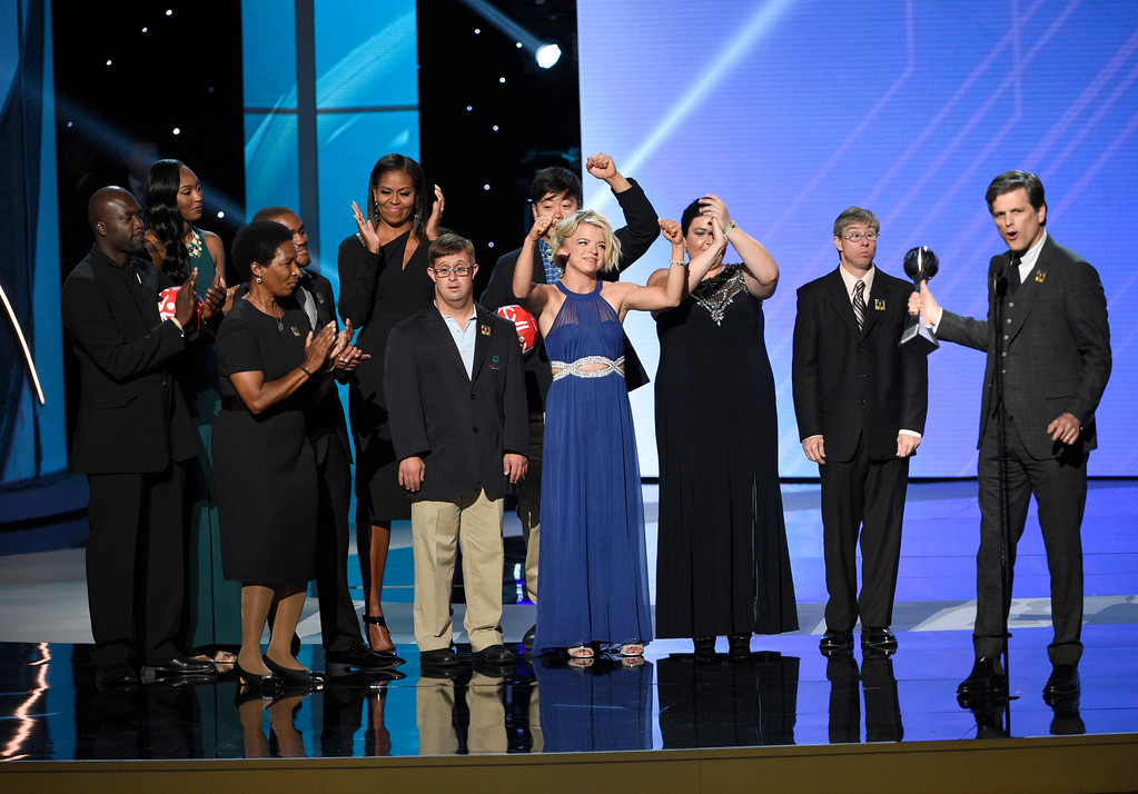 . Timothy Shriver accepts the Arthur Ashe Courage Award on behalf of his late mother, Special Olympics founder Eunice Kennedy Shriver, from former first lady Michelle Obama and Special Olympic athletes at the ESPYS at the Microsoft Theater on Wednesday, July 12, 2017, in Los Angeles. (Photo by Chris Pizzello/Invision/AP)