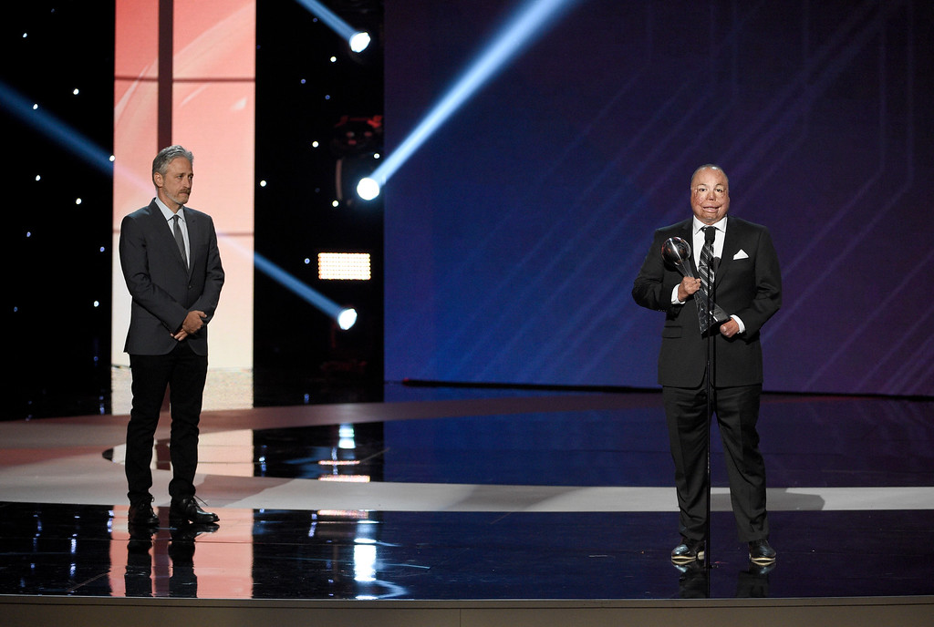 . Air Force Master Sgt. Israel Del Toro Jr. accepts the Pat Tillman award for service at the ESPYS at the Microsoft Theater on Wednesday, July 12, 2017, in Los Angeles. Looking on at left is presenter Jon Stewart. (Photo by Chris Pizzello/Invision/AP)