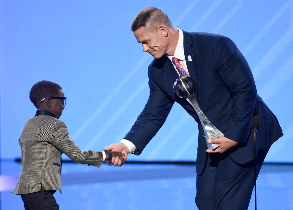 """. John Cena, right, presents New Orleans Saints superfan Jarrius \""""J.J.\"""" Robertson the Jimmy V perseverance award at the ESPYS at the Microsoft Theater on Wednesday, July 12, 2017, in Los Angeles. (Photo by Chris Pizzello/Invision/AP)"""