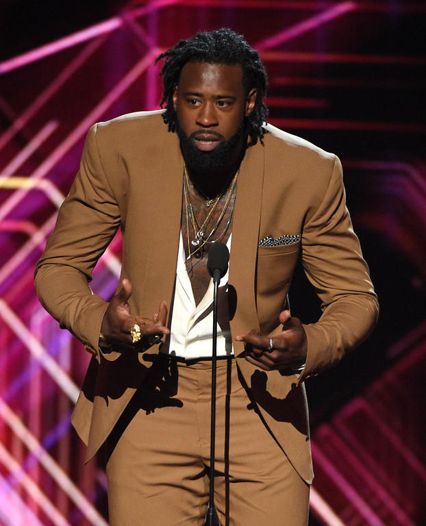 . NBA basketball player Deandre Jordan of the Los Angeles Clippers presents a tribute to athletes who have retired at the ESPYS at the Microsoft Theater on Wednesday, July 12, 2017, in Los Angeles. (Photo by Chris Pizzello/Invision/AP)