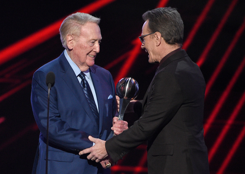 . Vin Scully, left, accepts the Icon Award from Bryan Cranston at the ESPYS at the Microsoft Theater on Wednesday, July 12, 2017, in Los Angeles. (Photo by Chris Pizzello/Invision/AP)