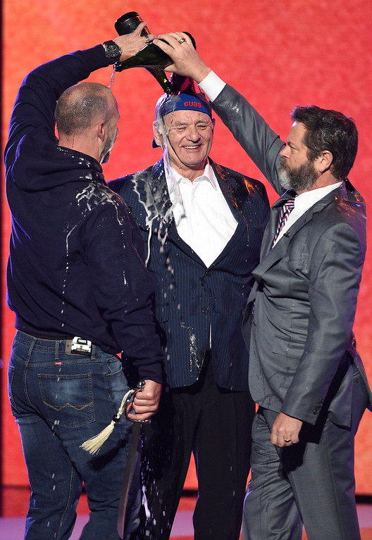 . Retired MLB baseball player David Ross, from left, Nick Offerman and Bill Murray toast the Chicago Cubs as they accept the team\'s award for best moment at the ESPYS at the Microsoft Theater on Wednesday, July 12, 2017, in Los Angeles. (Photo by Chris Pizzello/Invision/AP)