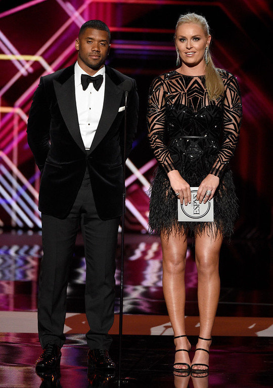 . NFL player Russell Wilson, of the Seattle Seahawks, left, and Lindsey Vonn present the award for best female athlete at the ESPYS at the Microsoft Theater on Wednesday, July 12, 2017, in Los Angeles. (Photo by Chris Pizzello/Invision/AP)