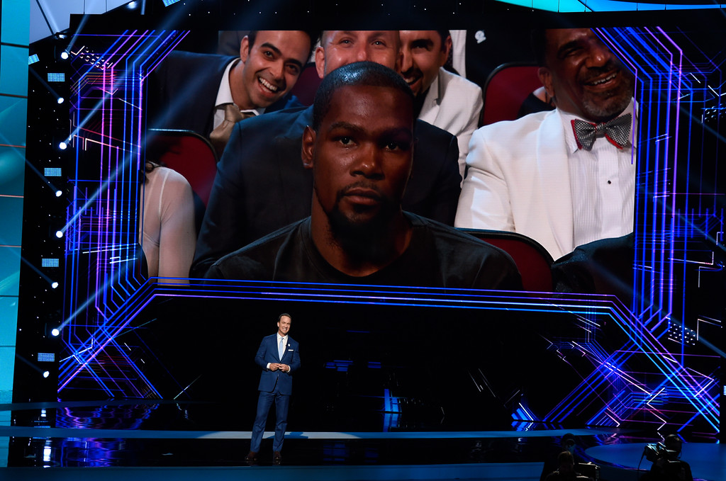 . Host Peyton Manning speaks at the ESPYS at the Microsoft Theater on Wednesday, July 12, 2017, in Los Angeles. Pictured on screen is NBA player Kevin Durant, of the Golden State Warriors. (Photo by Chris Pizzello/Invision/AP)