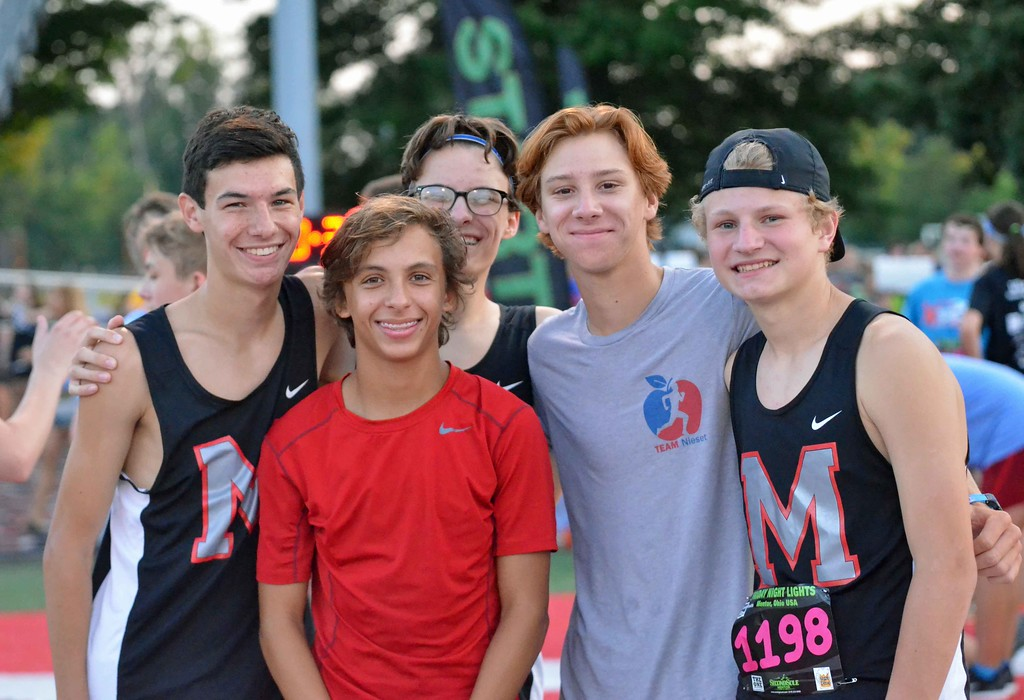 . Paul DiCicco - The News-Herald Action from the Friday Night Lights 5K race at Mentor\'s Jerome T. Osborne Stadium on July 13.