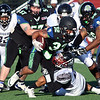 Randy Meyers - The Morning Journal<br> Nightmares running back Dontez Smith picks up short yardage against the Ohio Raiders during the first quarter on July 15 at Oberlin College.