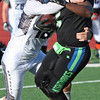 Randy Meyers - The Morning Journal<br> The Nightmares' C.J. Powell is hit hard by Marlon Oden of the Ohio Raiders after a short gain during the first quarter on July 15.