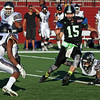 Randy Meyers - The Morning Journal<br> Nightmares quarterback James Mees runs through the Ohio Raiders defense for a big gain during the second quarter on July 15.