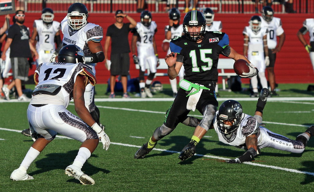 . Randy Meyers - The Morning Journal<br> Nightmares quarterback James Mees runs through the Ohio Raiders defense for a big gain during the second quarter on July 15.