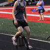 Michael Johnson  - The News-Herald<br /> Derynn Martin rides her unicycle during the Friday Night Lights 5K at Mentor High School on July 15.