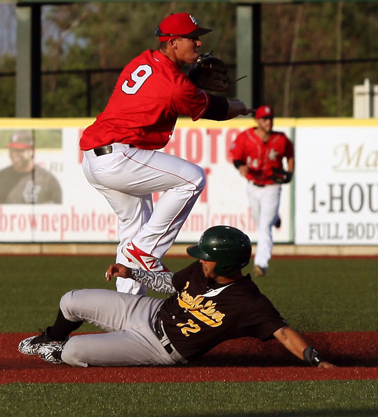 RANDY MEYERS  THE MORNING JOURNAL Crushers shortstop Eric Grabe forces out Santiago Chirino of the Cornbelters.