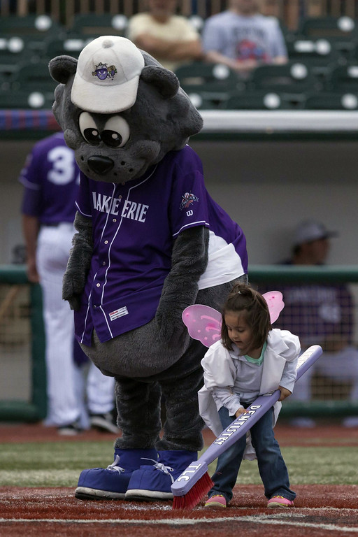 ". Jen Forbus - The Morning Journal Crushers mascot, Stomper, helps the ""tooth fairy\"" clean home plate between innings during Lake Erie\'s contest against the Southern Illinois Miners July 22."