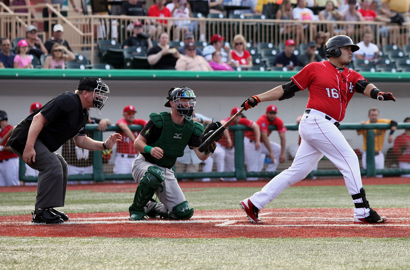 The Crushers' Jose Barraza slices a ball foul against the Cornbelters. Randy Meyers -- The Morning Journal