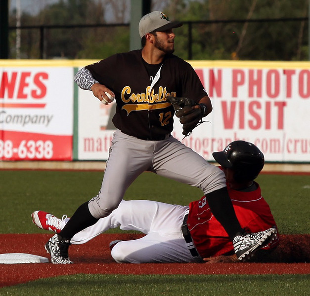 Eric Grabe of the Crushers is forced out at second by the Cornbelters' Santiago Chirino. Randy Meyers -- The Morning Journal