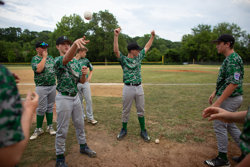 . The Englewood baseball team warms up prior to their game against Loveland at Kiwanis Recreation Park in Painesville, Ohio, on July 23, 2018.