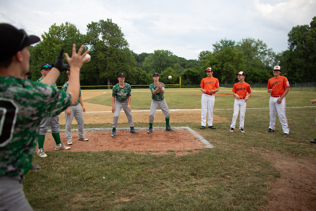 . Loveland and Englewood play a game together before their matchup in an Ohio State Junior Baseball League game at Kiwanis Recreation Park in Painesville, Ohio, on July 23, 2018.