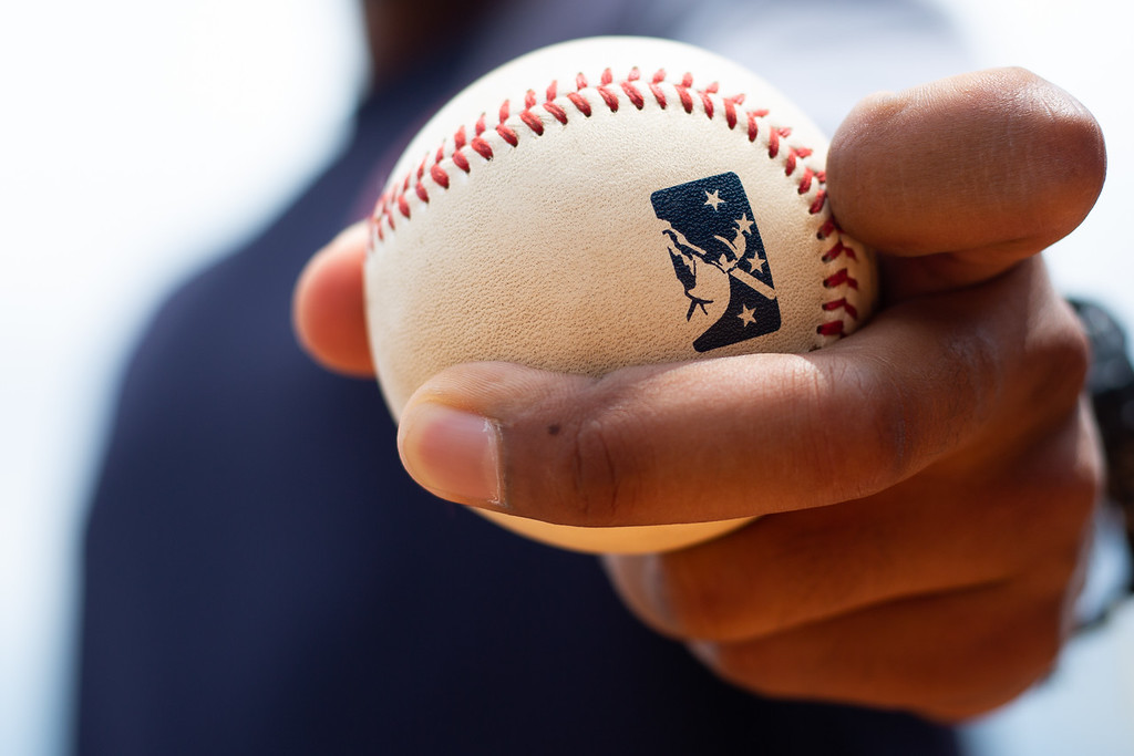 . Michael Johnson - The News-Herald Lake County Captains pitching coach Joe Torres shows the grip for a spike curveball.