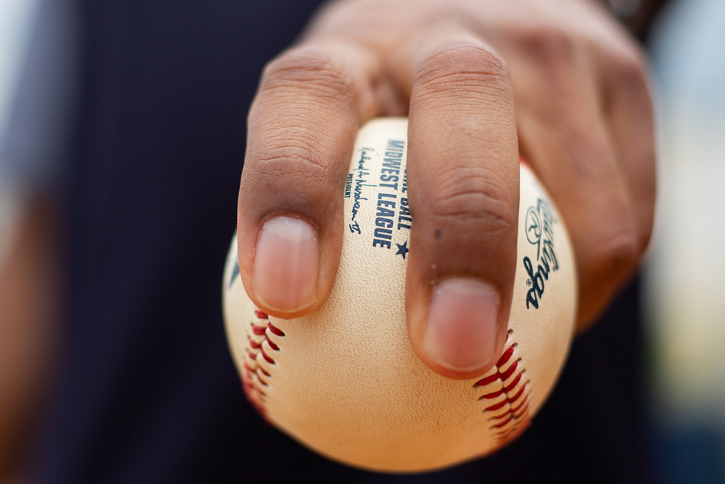 . Michael Johnson - The News-Herald Lake County Captains pitching coach Joe Torres shows the grip for a two-seam fastball.