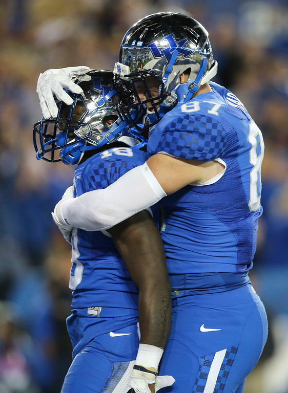 . Kentucky running back Stanley Williams is congratulated by Kentucky tight end C.J. Conrad after Williams scored a touchdown during the second half of an NCAA college football game against Auburn, Thursday, Oct. 15, 2015, in Lexington, Ky. Auburn won the game 30-27. (AP Photo/David Stephenson)