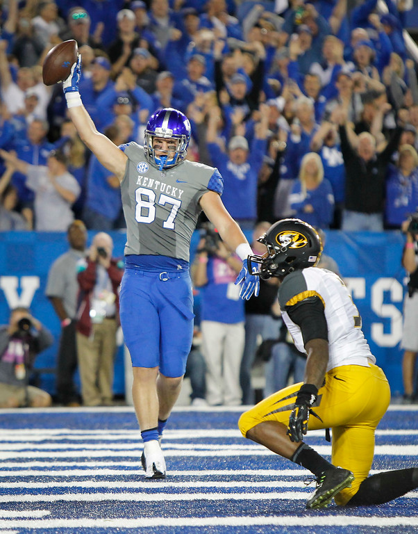 . Kentucky tight end C.J. Conrad celebrates a touchdown in front of Missouri safety Cortland Browning during the second half of an NCAA college football game Saturday, Sept. 26, 2015, in Lexington, Ky. Kentucky won the game 21-13. (AP Photo/David Stephenson)