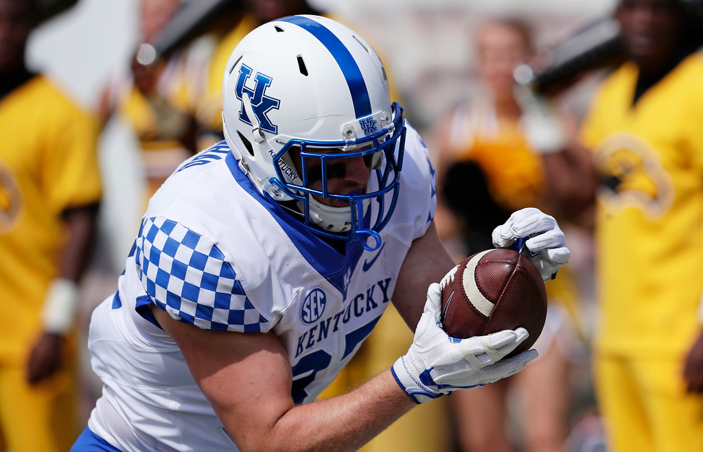 . Kentucky tight end C.J. Conrad (87) dives forward following a 59-yard first half pass reception against Southern Mississippi during an NCAA college football game in Hattiesburg, Miss., Saturday, Sept. 2, 2017. Kentucky won 24-17. (AP Photo/Rogelio V. Solis)