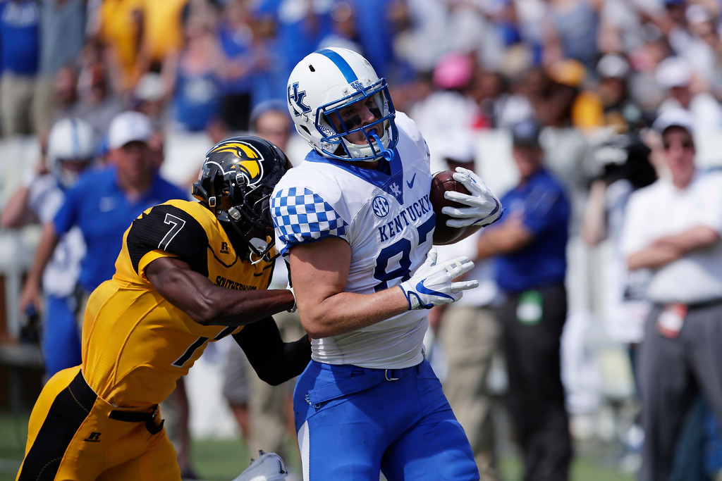 . Kentucky tight end C.J. Conrad (87) rushes past Southern Mississippi defensive back Jomez Applewhite (7) for a 59-yard first half pass reception during an NCAA college football game in Hattiesburg, Miss., Saturday, Sept. 2, 2017. Kentucky won 24-17. (AP Photo/Rogelio V. Solis)