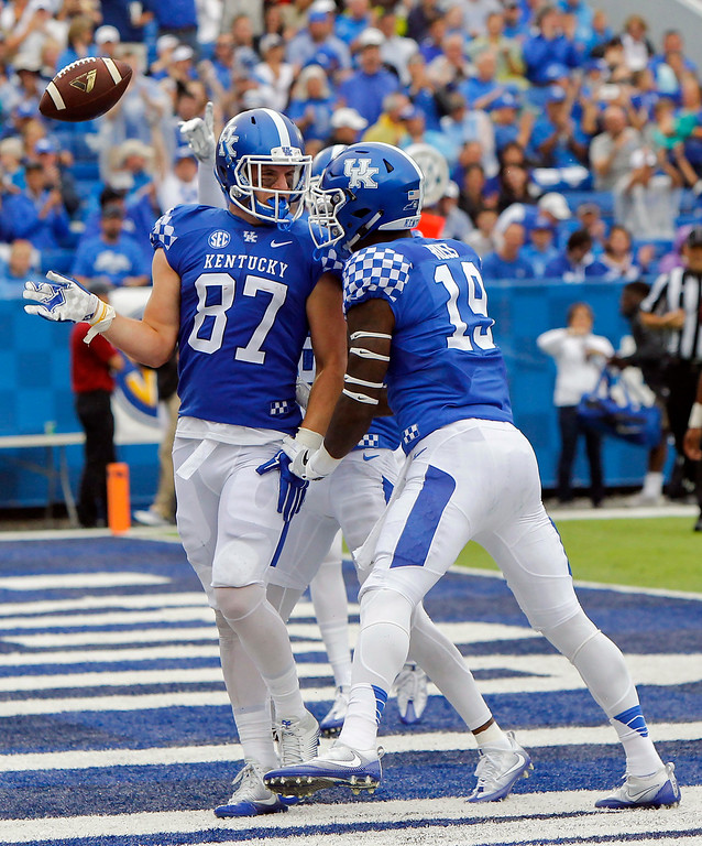 . Kentucky tight end C.J. Conrad, left, celebrates his touchdown with teammate Kayaune Ross, right, in the first half of an NCAA college football game against New Mexico State, Saturday, Sept. 17, 2016, in Lexington, Ky. (AP Photo/David Stephenson)