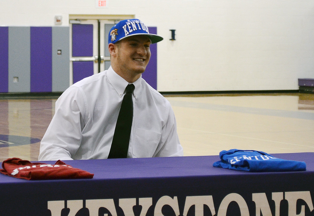 . Morning Journal File<br> Keystone junior tight end C.J. Conrad smiles putting on a University of Kentucky hat to announce his decision to play football for the Wildcats. Conrad\'s decision came down to Kentucky and Indiana University.